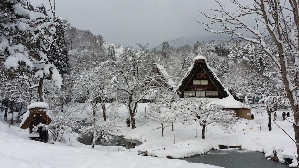 snow covered Shirakawago with frozen ponds