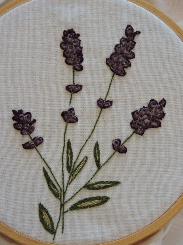 close up of embroidered lavender flowers