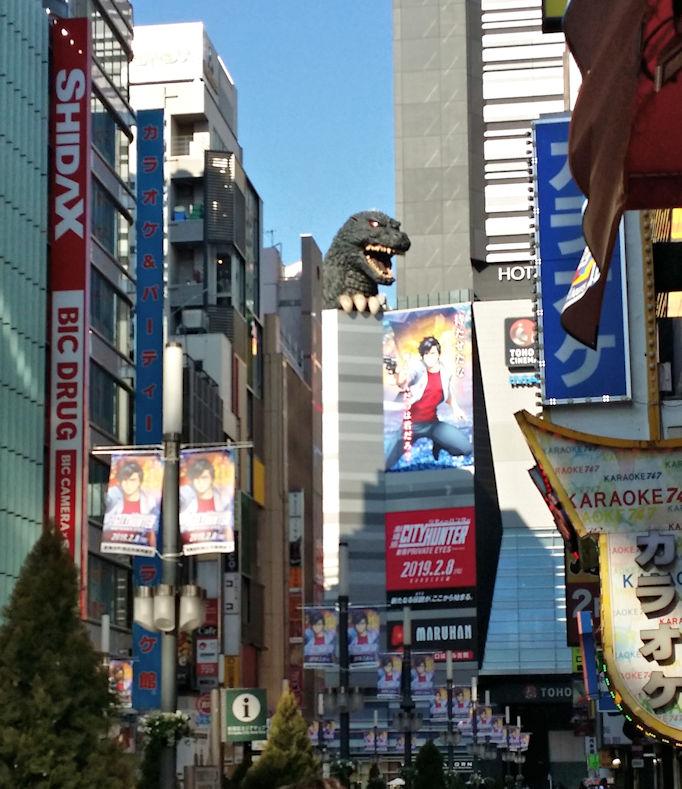 Godzilla head above building in Shinjuku