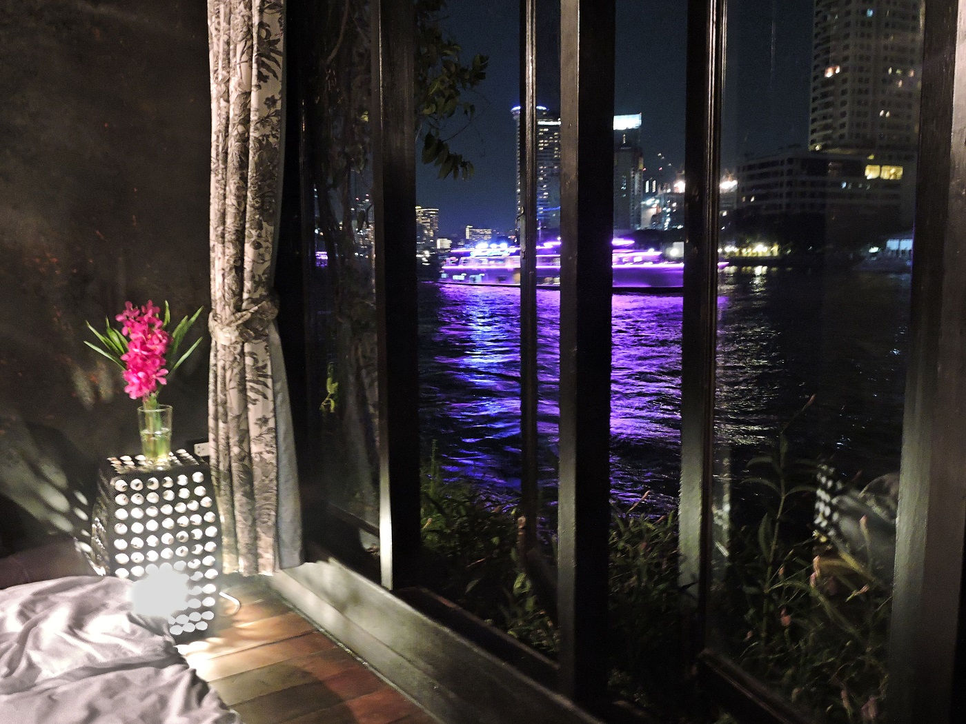 night time view from hotel room of river with lights