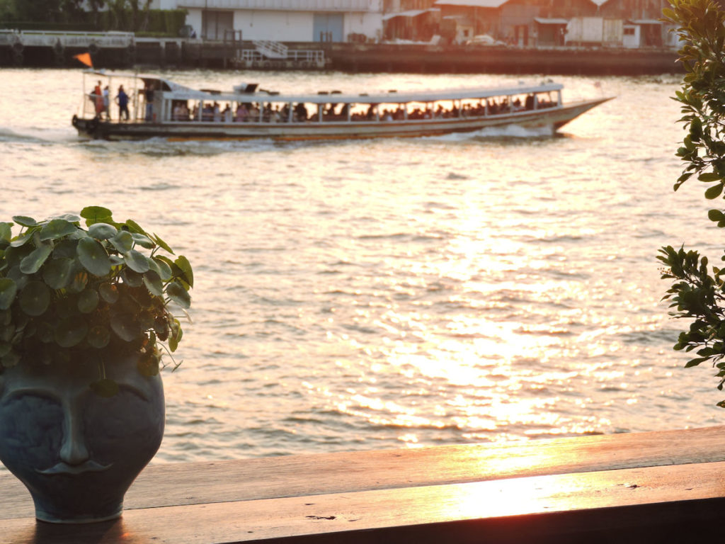 sunsetting over the chao phraya river