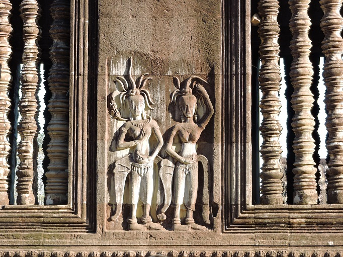 carved relief artwork of figures with headdress
