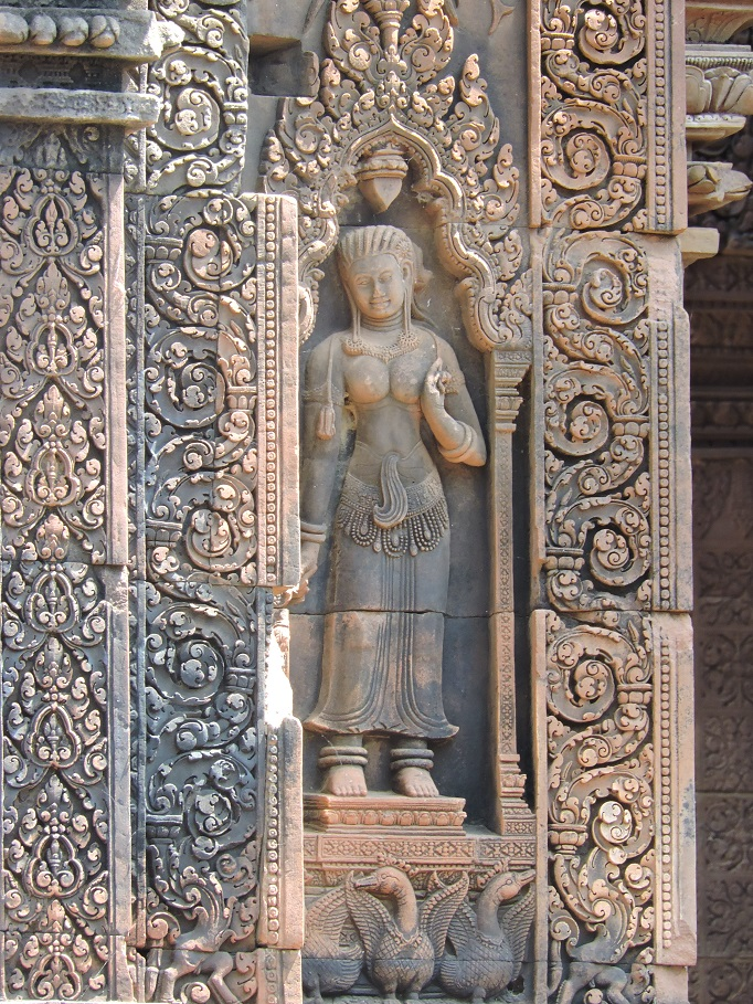 art relief carving of lady and scroll work
