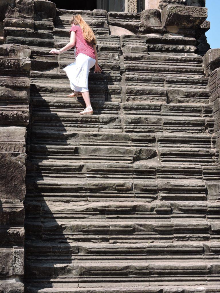 climbing steps to library at Angkor Wat