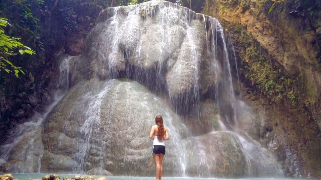 standing in front of Aguinid waterfall