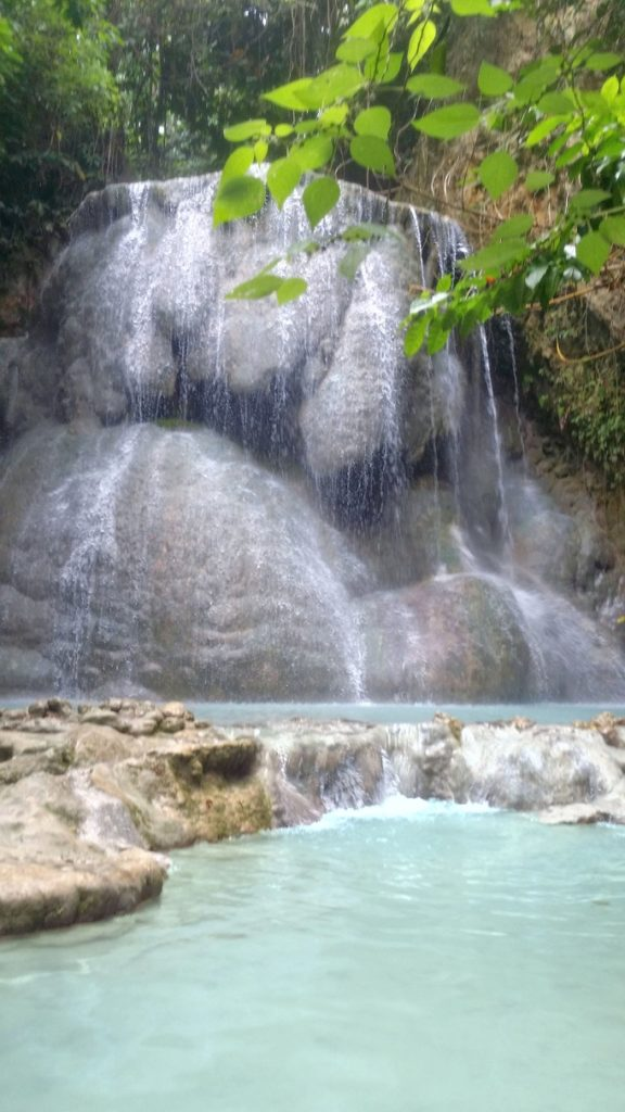 middle level Aguinid falls with bulbous rock formations and blue white water
