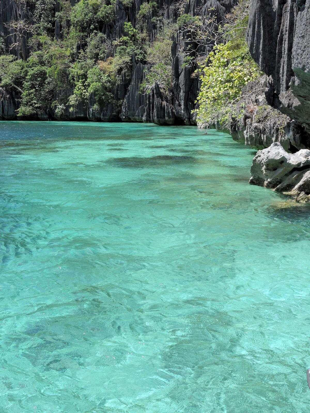 aqua blue water and sheer rock clifs