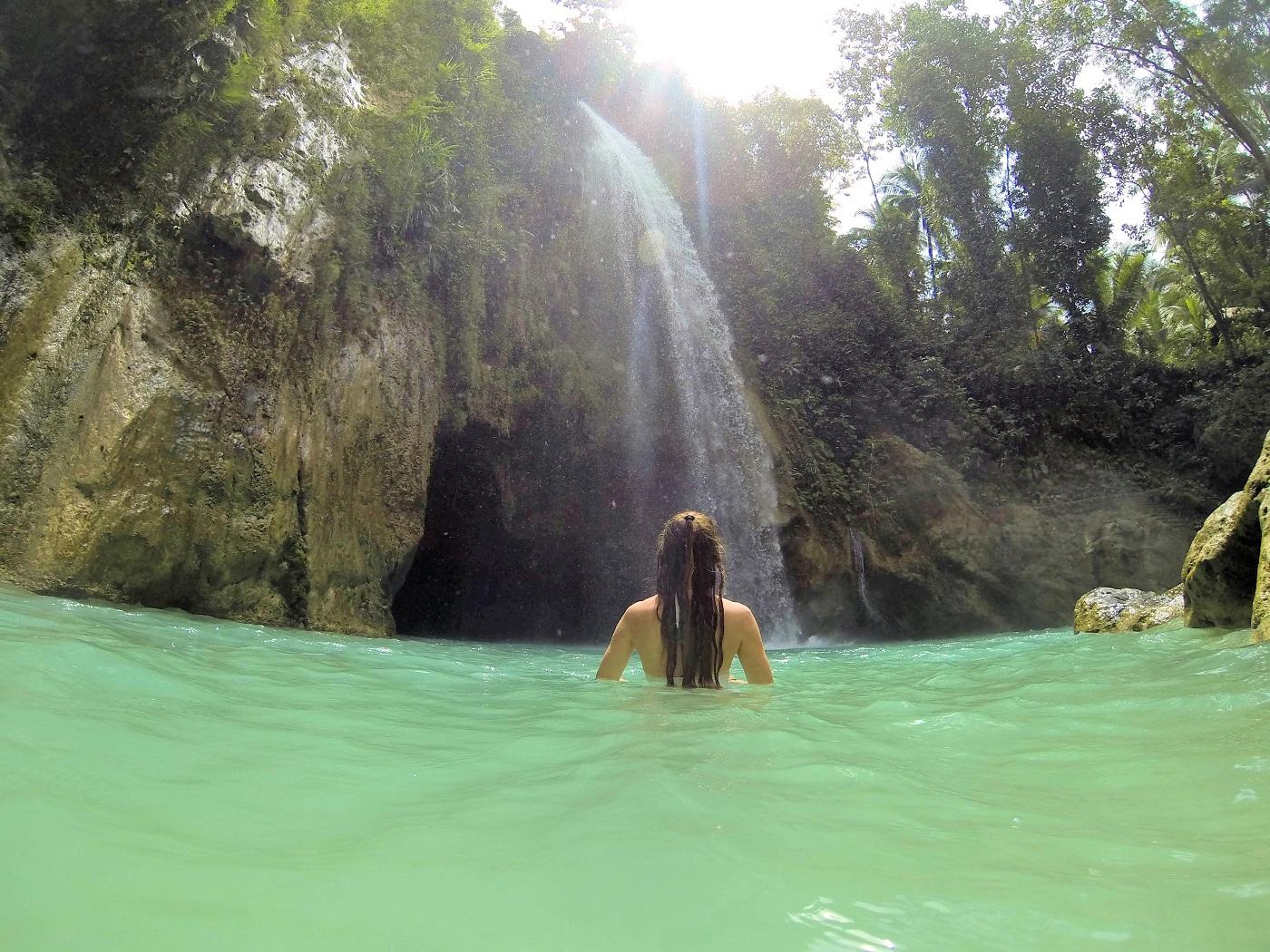 swiming in the green blue falls of jungle Inambakan