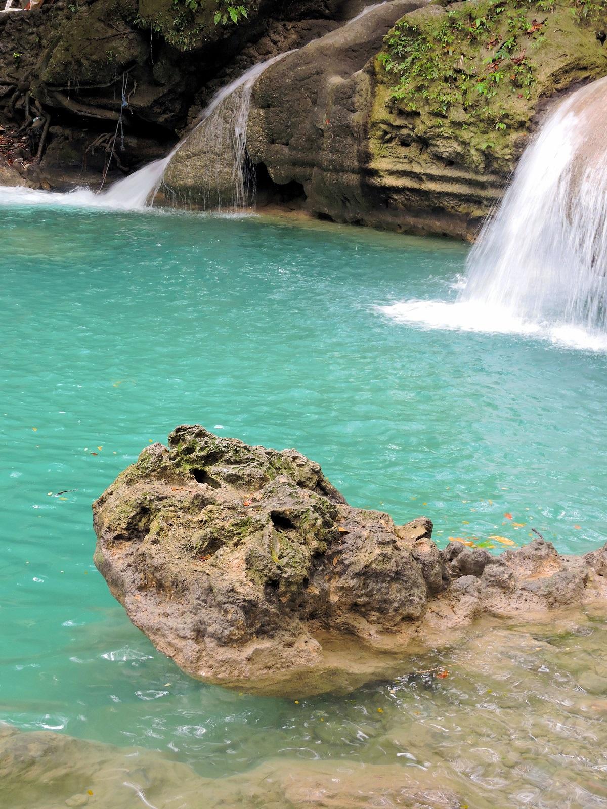 crazy blue pool of water upper falls Kawasan