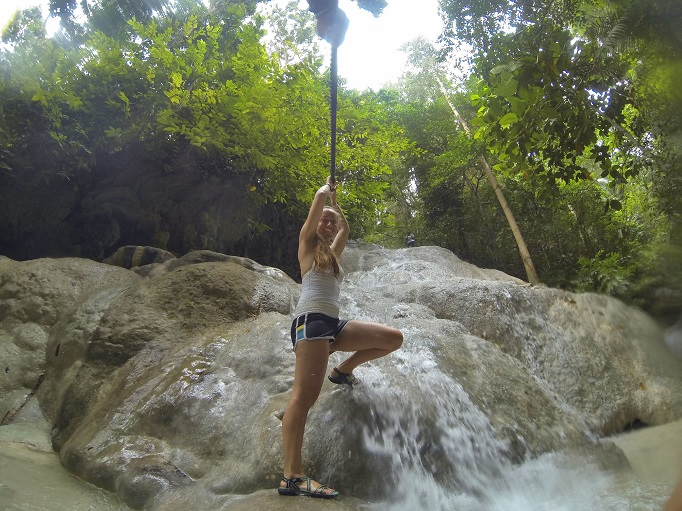 using a rope to climb up middle level of Aguinid falls