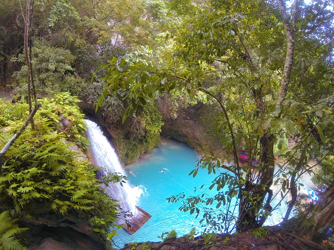Kawasan heading to upper levels looking down on blue water pool