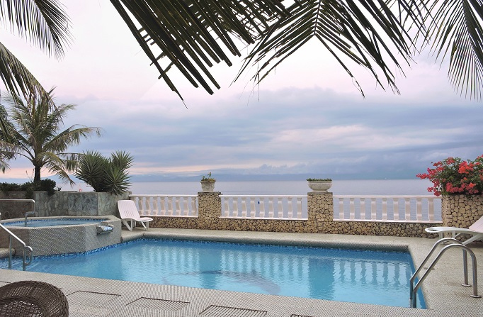 pool at hotel with view of ocean