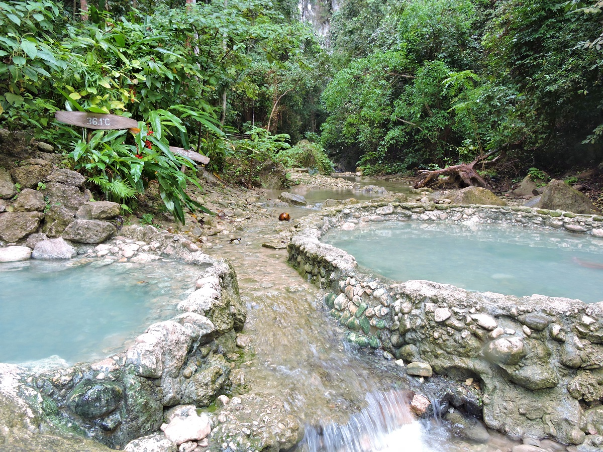 two hotsprings with river and jungle
