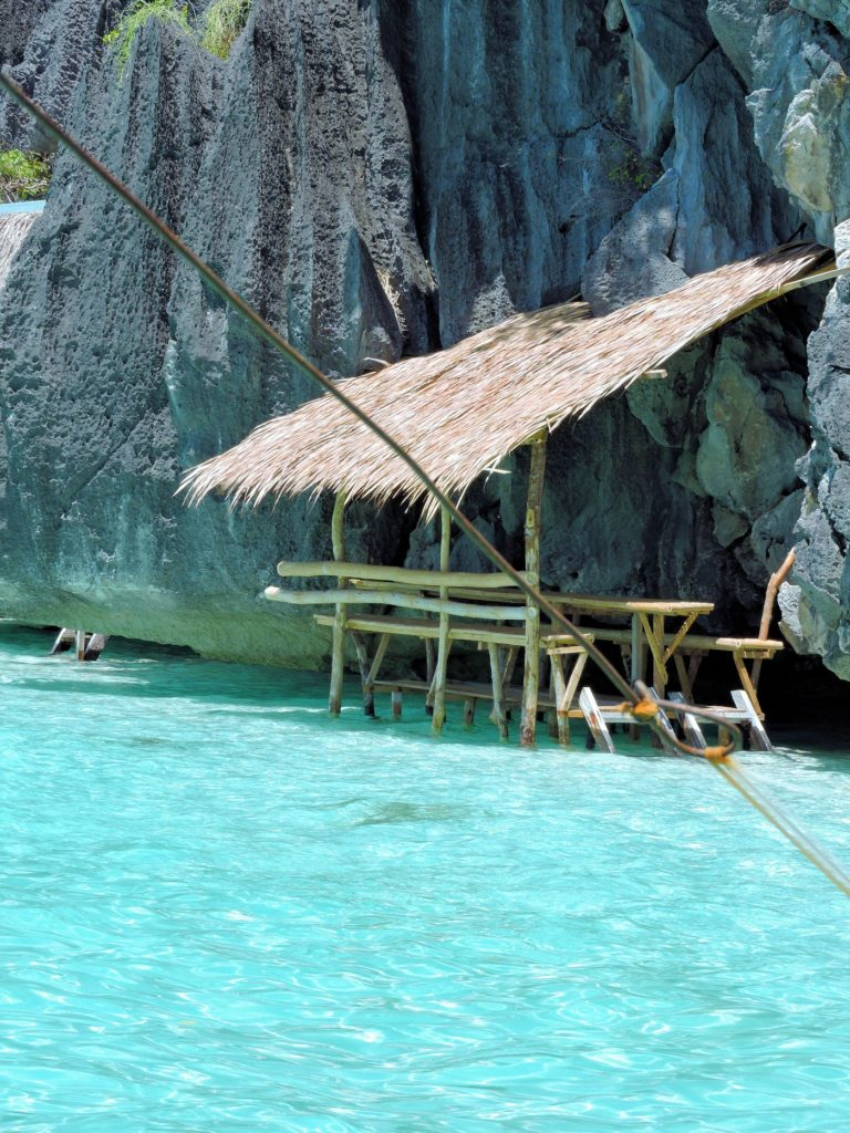 lunch hut over blue water