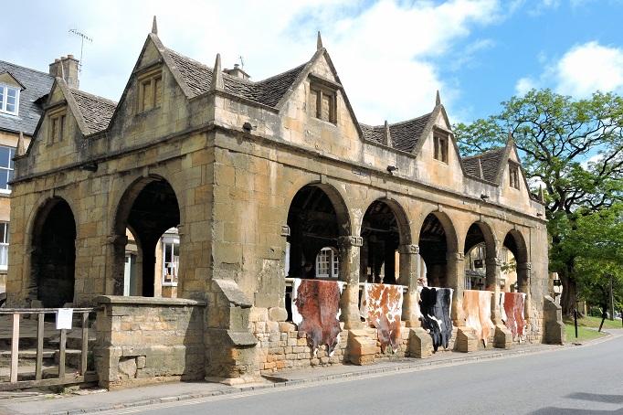 old stone building with cow hides for sale
