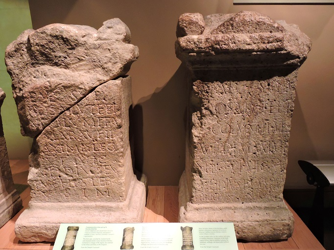 two stone altars from roman baths in museum