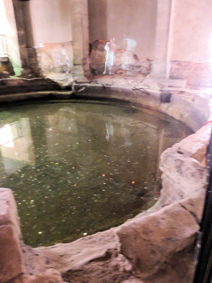 pool in roman baths with holographic projections