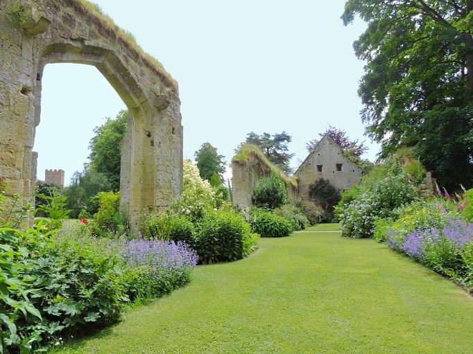 stone ruins with flower garden growing around