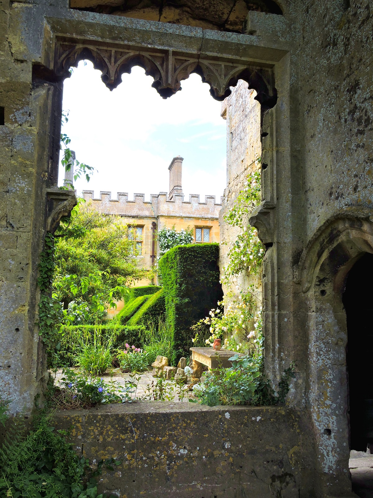 looking through old catle wall to gardens