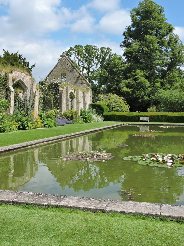 water garden with stone building ruins