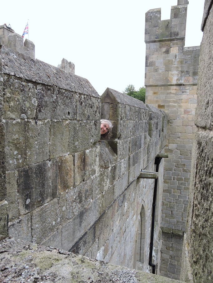 mom peering out of battlements