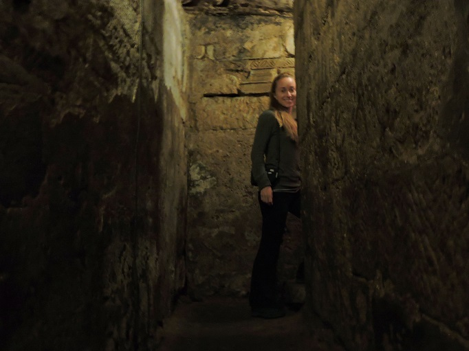 walking in dark Abbey crypt