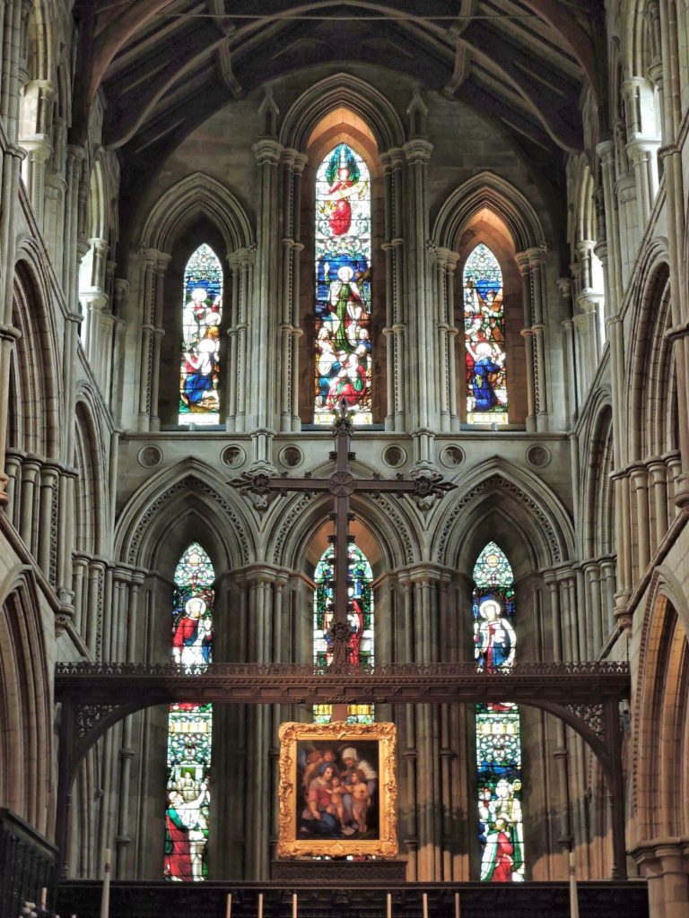 stained glass windows and altar cross