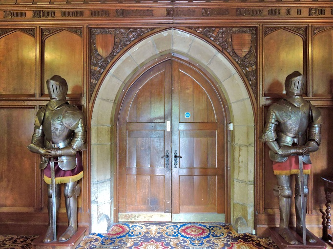 knights armour standing by door