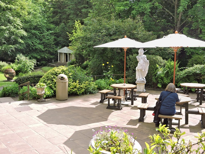 outdoor cafe surrounded by gardens