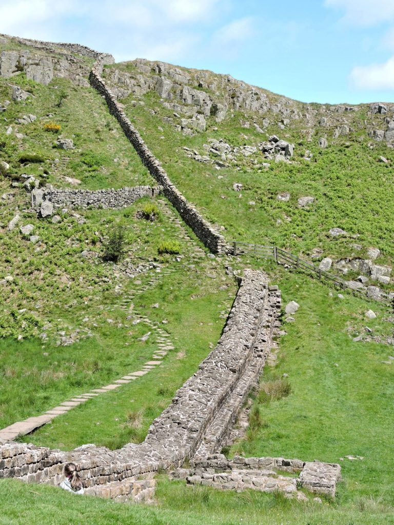 hadrian's wall ruins going up steep incline